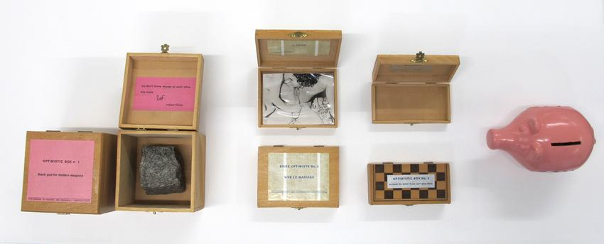 ROBERT FILLIOU (1926-1987)<br />4 boîtes optimistes / 4 optimistic boxes: n°1,<br />n°2,n°3, n°4&5<br />1968-1981<br />n°1: wooden box, printed labels, stone<br />  4 3/8 x 4 3/8 x4 3/8 inches (11 x 11 x 11 cm)<br />n°2: wooden box, printed labels, photograph<br />  1 x 3 1/2 x 4 3/4 inches  (2.7 x 9 x 12 cm)<br />n°3: chessboard box, printed labels<br />  1 1/8 x 2 3/8 x 4 3/4 inches (3 x 6 x 12 cm)<br />n°4et5: painted ceramic, printed labels<br />  4 1/8 x 6 x 3 1/2 inches (10.5 x 15.5 x 9 cm)<br />