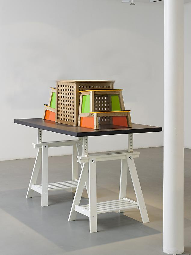 <u>Ikea Variations : Kindergarten, 2007</u><br />wood, plexiglass and 2 figurines<br />56 5/16 x 39 3/8 x 59 inches (143 x 100 x 150 cm)<br />base: 37.4 x 39.37 x 59 inches (95 x 100 x 150 cm)<br />architecture: 18.9 x 19.69 x 48 inches (18 x 50 x 122 cm)<br />