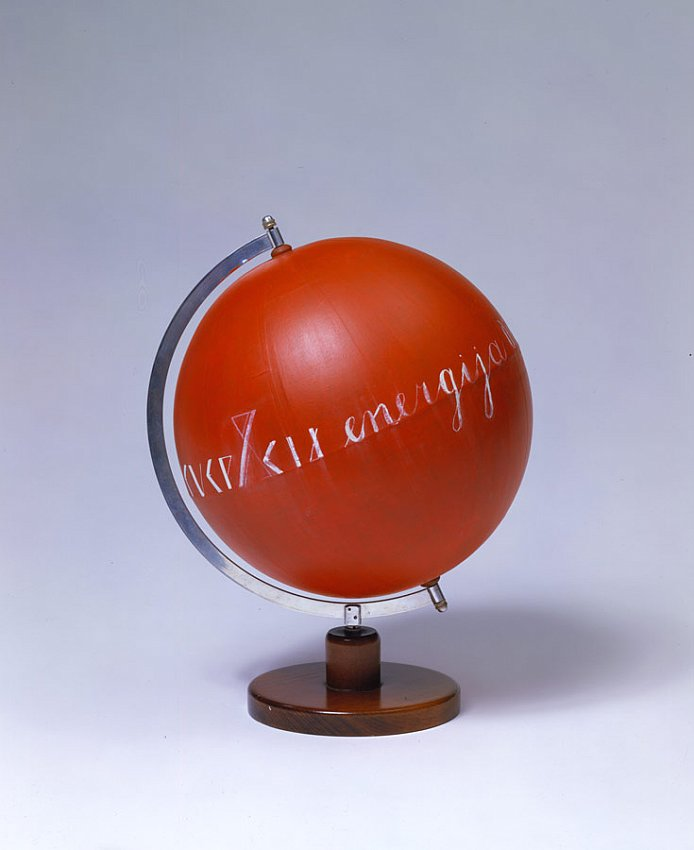 MANGELOS  (1921 - 1987)<br /><i>Energija</i><br />c. 1978<br />acrylic and oil on globe made of wood, metal and paper<br />height: 18 1/8 inches (46 cm)<br />diameter: 14 1/8 inches (36 cm)<br />