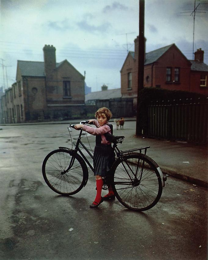 Evelyn Hofer<br />Girl with Bicycle<br />1966<br />dye transfer print<br />19 7/8 x 16 inches (50.5 x 40.5 cm)<br />PF1967<br />minimum donation: EUR 8,800.<br />(including frame)<br />