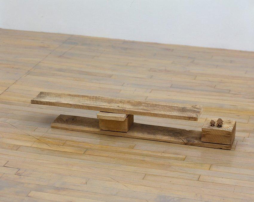 Helen Mirra<br />Sarton<br />2006<br />pallet wood, pine cones<br />6 1/16 x 41 x 8 inches<br /> (15 x 104 x 20 cm)<br />