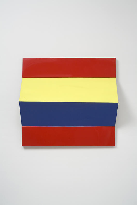 CHARLOTTE POSENENSKE<br /><i>Faltung</i> (Fold)<br />1966<br />RAL red, yellow, and blue spray paint on folded sheet aluminum<br />28 1/6 x 26 3/8 x 6 1/4 inches (71.6 x 67 x 15.8 cm)<br />