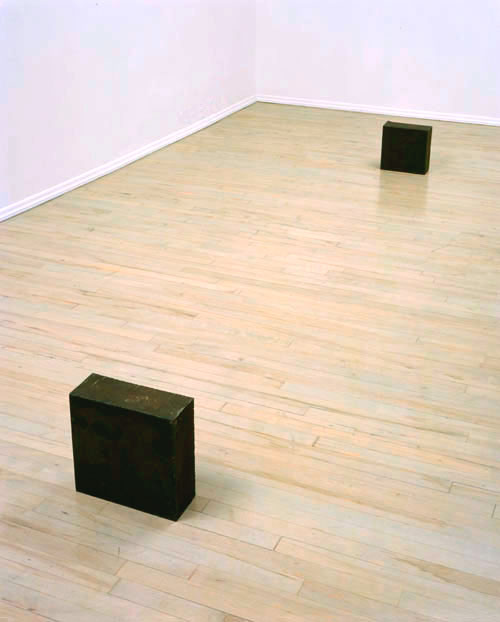 RICHARD SERRA<br />Unequal Elevations<br />1973<br />hot-rolled steel, in two parts<br />first block: 11 x 11 x 5 inches <br />  (27.9 x 27.9 x 12.7 cm); <br />second block: 12 1/16 x 12 1/16 x 5 1/4 inches<br />  (30.5 x 30.5 x 13.3 cm)<br />