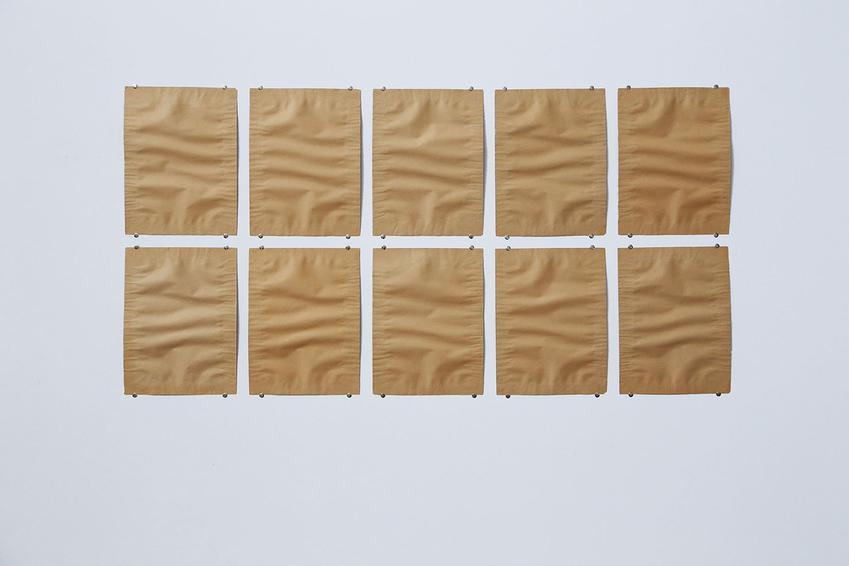 FRANZ ERHARD WALTHER<br /><i>Zehnteilige Auslegearbeit aus grau-braunem Papier</i><br />1962<br />two sheets of brown paper affixed together, in ten parts<br />Each:12 x 9 inches (30.3 x 23 cm)<br />