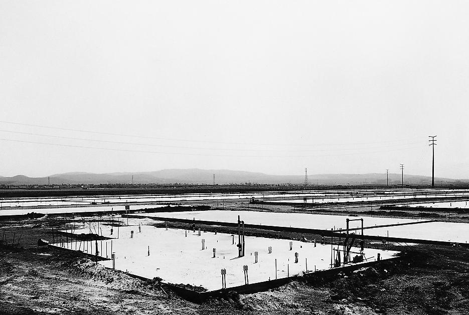 Lewis Baltz <i>NIP #14: Foundation Construction, Many Warehouses, 2892 Kelvin, Irvine</i> 1974 Vintage gelatin silver print 8 x 10 inches