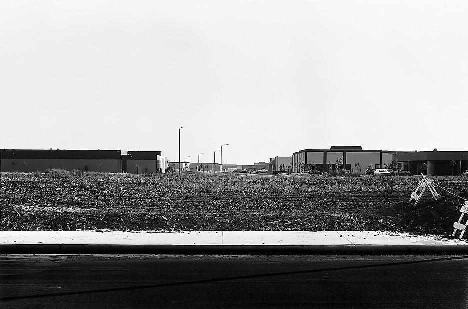 Lewis Baltz <i>NIP #33: Barranca Road, between Von Karmaan and Milliken Roads, looking Southwest</i> 1974 Vintage gelatin silver print 14 x 17 inch Halbe frame