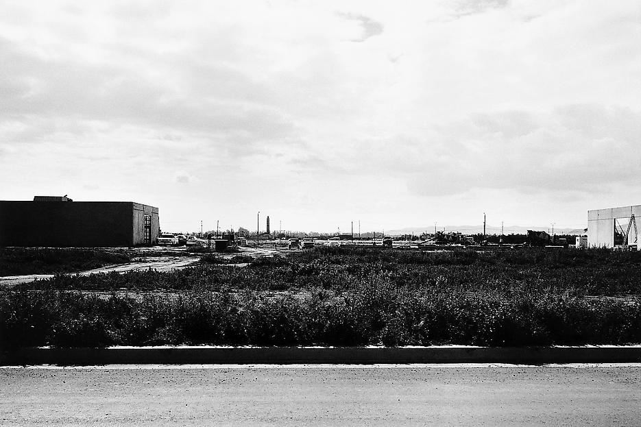 Lewis Baltz <i>NIP #34: Milliken Road, between Gates and DuBridge Roads, looking East</i> 1974 Vintage gelatin silver print 14 x 17 inch Halbe frame