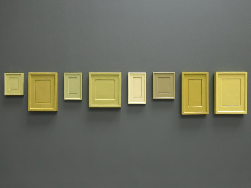 Allan McCollum in collaboration with Andrea Zittel <i>Collection of Eight Plaster Surrogates</i> Mold: 1982, Cast: 1993, Painted: 2013 Enamel on cast Hydrostone  Installed Dimensions: 9.5 x 55 inches; 24.1 x 139.7 cm