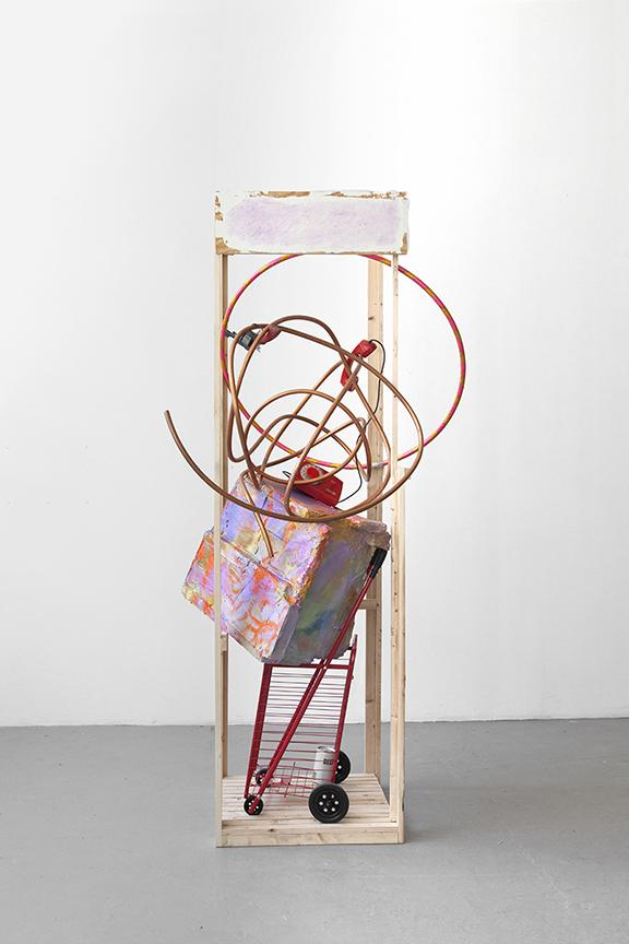 Rachel Harrison <i>*69</i> 2014 Wood, polystyrene, cement, acrylic, shopping cart, copper telephone hula hoop, beer can, and toy gun 84 x 38 1/2 x 42 1/2 inches