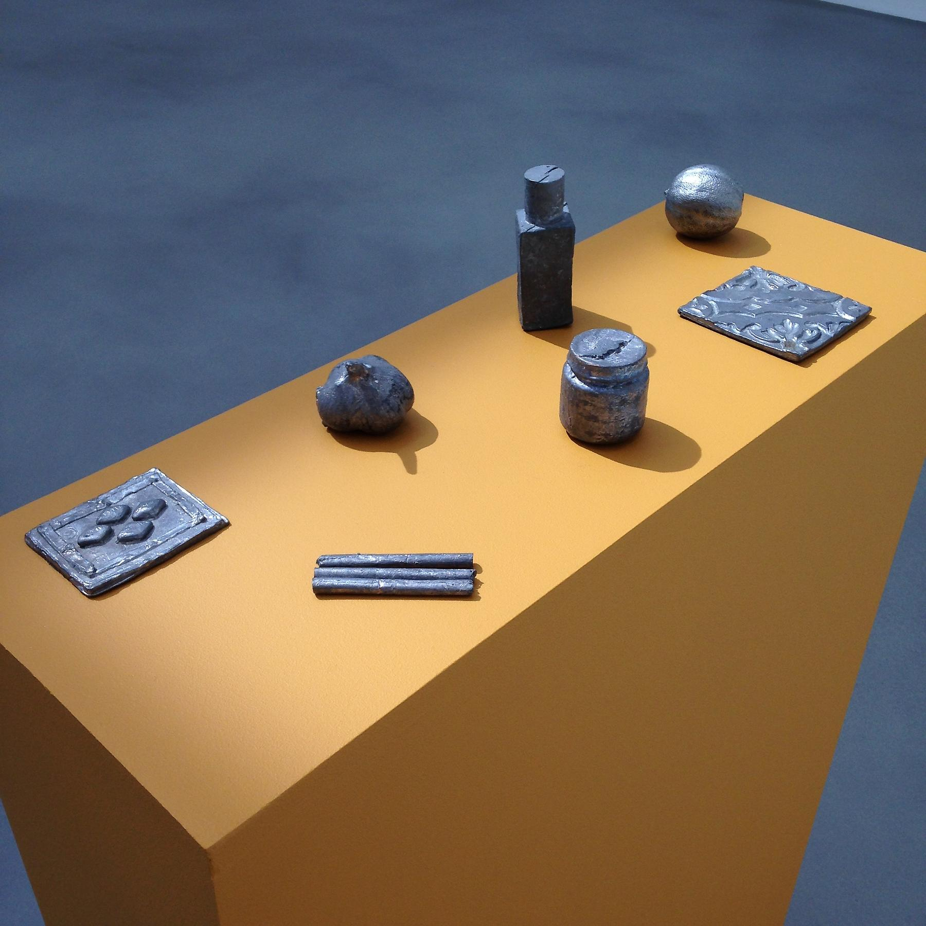 Liz Glynn <i>Smuggled Fragments from Anonymous Needs and Desires (Gaza/Giza) (3 cigarettes, baby food, garlic, perfume, lemon, and Viagara)</i> 2012 Cast lead Dimensions variable
