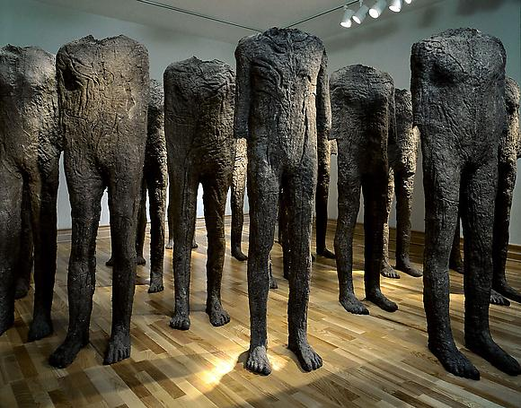 Crowd No. 2, 1988 20 figures in burlap and resin 66 7/8 x 19 1/2 x 11 3/4 inches 170 x 49.5 x 29.8 cm