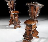 A Pair of Carved Walnut Sgabello Chairs