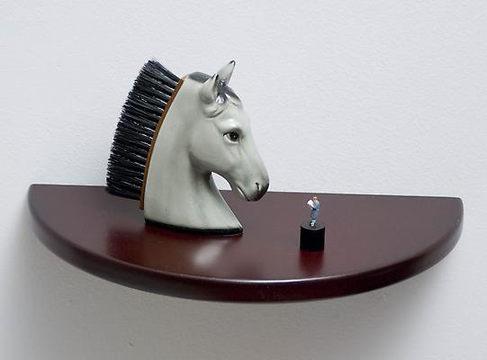 The Tale, 2011 Figurines on wooden shelf, wall installation 6 x 12 x 6 inches Image