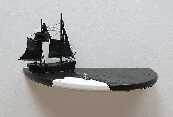 Black Spill (man in green outfit), 2011 Figurine, ship, and acrylic on wooden shelf, wall installation 6 3/4 x 14 x 7 1/2 inches Image