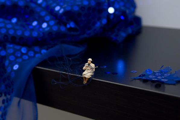 Forced Labor (Seamstress), 2012 Detail Shelf with figurine and fabric, wall installation 10 x 43 x 10 1/4 inches Image