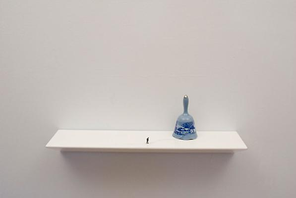 To Go Back (blue bell), 2011 porcelain bell, figurine, ink, and shelf 9 x 24 x 6 inches Image