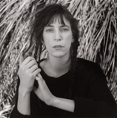 Patti Smith, 1987  gelatin silver print image: 19 1/4 x 19 1/4 inches  (48.9 x 48.9 cm) paper: 24 x 20 inches  (61 x 50.8 cm) edition of 10 with 2 APs  MAP-1757