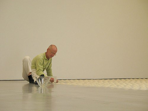 Wolfgang Laib installing: Without Place - Without Time - Without Body, 2007 rice mountains, 5 mountains with hazelnut pollen unique installation at Sean Kelly Gallery