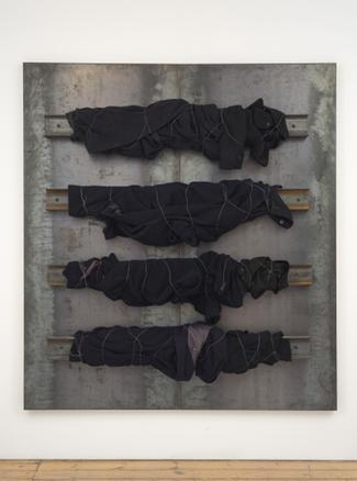 Untitled 1998 iron panel, coats, iron wire 200 x 180 cm
