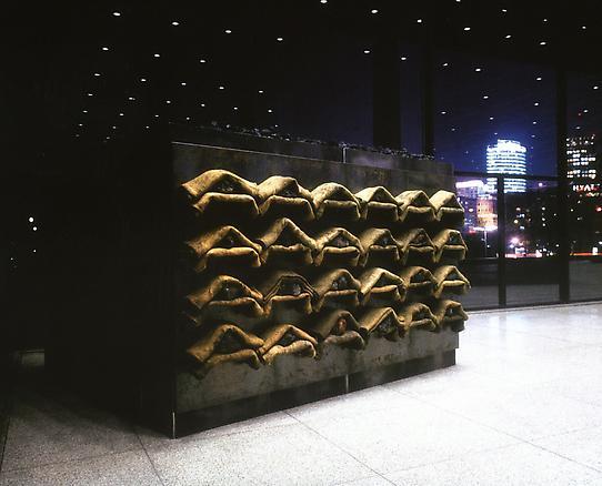 Untitled 1999 jute sac, volcanic stones, steel 200 x 360 x 39 cm