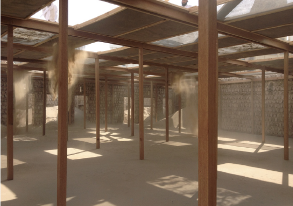 At the Risk of the Real 2015 wooden beams, sieves and sand 22.5 x 17.7 x 3.2 m exhibition view at Sharjah Biennial 12 2015