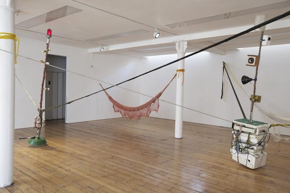 Spacemen/Cavemen 2011-2017 mixed media (two wooden poles, light bulbs, CD player, speakers, polystyrene, plastic bottle, ropes, ratchet straps, hammocks) dimensions variable  installation view