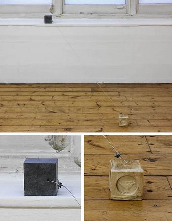 Marx between cubes  2016 slate, steel wire, soap 10 x 212 x 14 cm