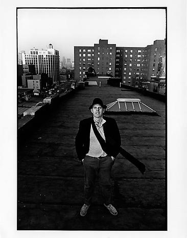 Ugo Mulas Claes Oldenburg on the roof of 404 East 14th St, NYC, 1967 gelatin-silver print 11 x 7 1/2 inches